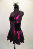 Fuchsia metallic camisole dress has full skirt with brief. Front is embellished with black velvet bow. Has black velvet corset belt & mini top-hat accessory. Left side