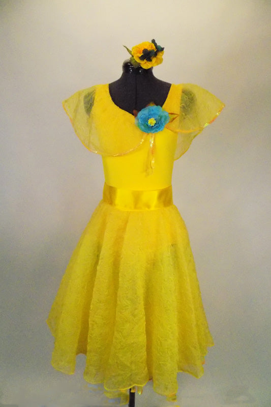 Sunshine yellow dress has full circle lace skit. The body is a Lycra tank base with lace Puritan collar & blue flower. Comes with sash & flower hair accessory. Front