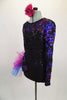 Black sequined leotard with sweetheart neckline has sheer black mesh upper with long sleeves covered in blue & magenta sequined swirls & large right hip pouf. Comes with matching floral hair accessory. Left side