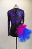 Black sequined leotard with sweetheart neckline has sheer black mesh upper with long sleeves covered in blue & magenta sequined swirls & large right hip pouf. Comes with matching floral hair accessory. Back