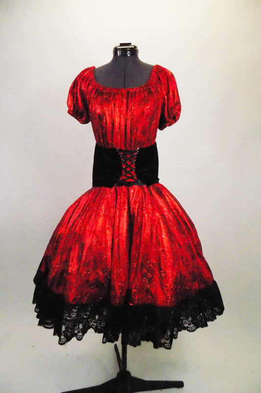 2-piece costume is a shimmery red with pouf sleeves & gathered bodice, accompanied by a matching skirt with layers of black tulle and black velvet corset belt. Comes with matching kerchief. Front