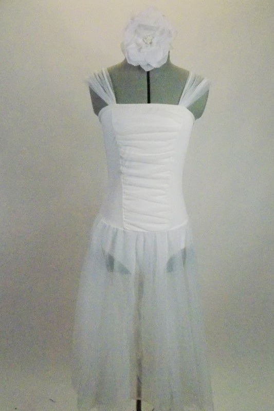 Soft, sheer white gossamer dress has sheer flowing skirt & ruching in front center of bodice, Has wide gossamer shoulder straps and floral hair accessory. Comes with floral hair accessory. Front