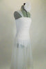 Soft, sheer white gossamer dress has sheer flowing skirt & ruching in front center of bodice, Has wide gossamer shoulder straps and floral hair accessory. Right side