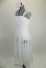 Soft, sheer white gossamer dress has sheer flowing skirt & ruching in front center of bodice, Has wide gossamer shoulder straps and floral hair accessory. Left side