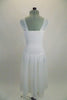Soft, sheer white gossamer dress has sheer flowing skirt & ruching in front center of bodice, Has wide gossamer shoulder straps and floral hair accessory. Back