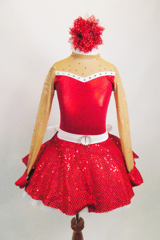 Red 2-piece crystal covered costume has sweetheart neck, nude sheer, upper, sleeves & keyhole back The skirt is a red sequined with crystal buckle & back bow. Comes with hair accessory. Front