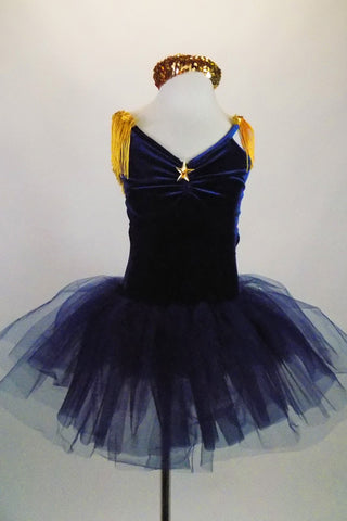 Navy blue velvet ballet dress has tulle tutu, pinch front with gold star and shoulders with tasseled epaulets. Comes with gold sequined headband. Front