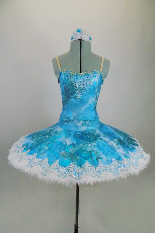 Professional hooped & tacked platter tutu has floral overlay in shades of turquoise. Tutu is edged with wide pearled bridal lace. Comes with hair accessory Front