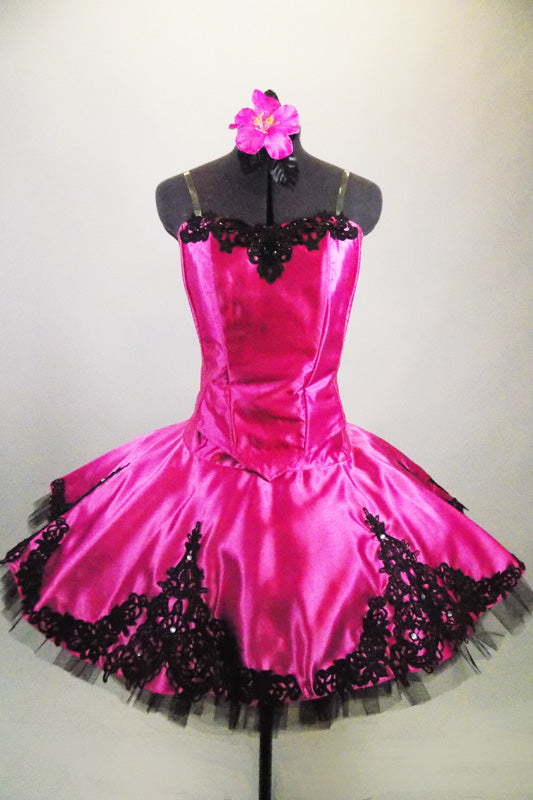Pink satin boned bodice with black beaded lace has matching satin wide lace scalloped overlay. Overlay sits on top of a black pleated & tacked tutu. Comes with hair accessory. Front