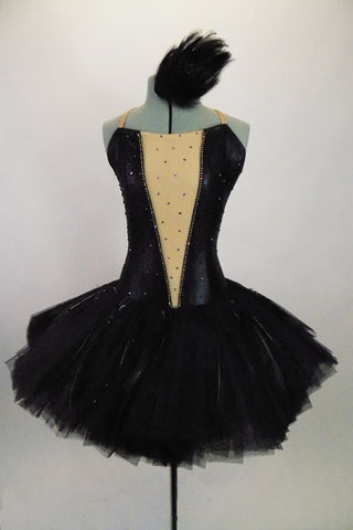 Professional Englishtutu adorned with black feathers has attached black low back bodice with nude center panel lined by crystals & scattered crystals throughout. Comes with feather hair accessory. Front