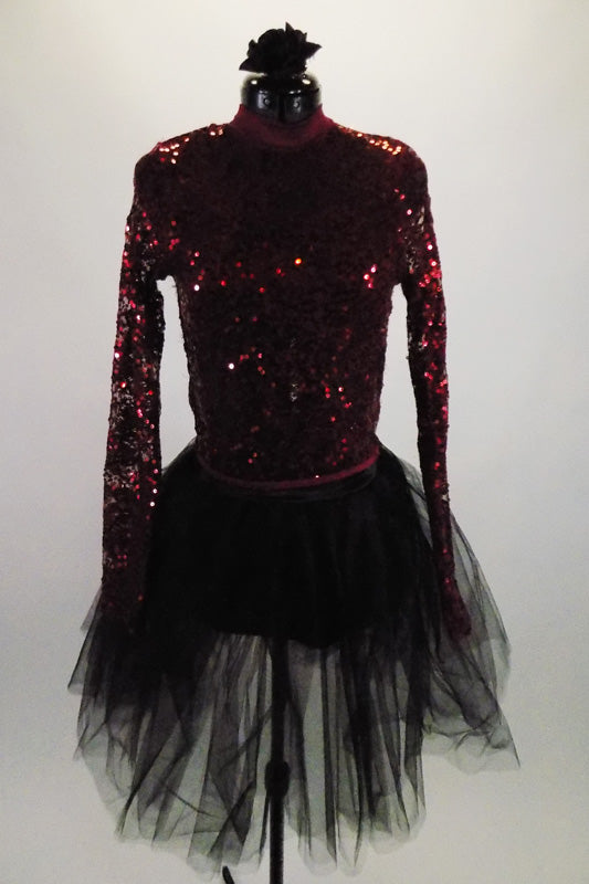 Burgundy sequined sheer long sleeved top with keyhole back sits over a burgundy bra top. The black brief bottoms & romantic tutu skirt complete the outfit. Front