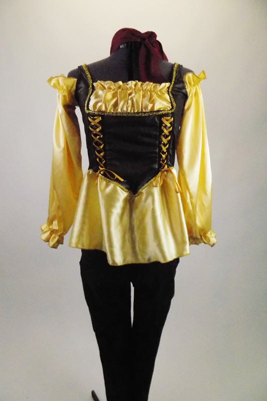 Wench girl themed costume has gold satin blouse with side-laced corset vest & blouson sleeves. Blouse is accompanied by black leggings &  burgundy hair band. Front
