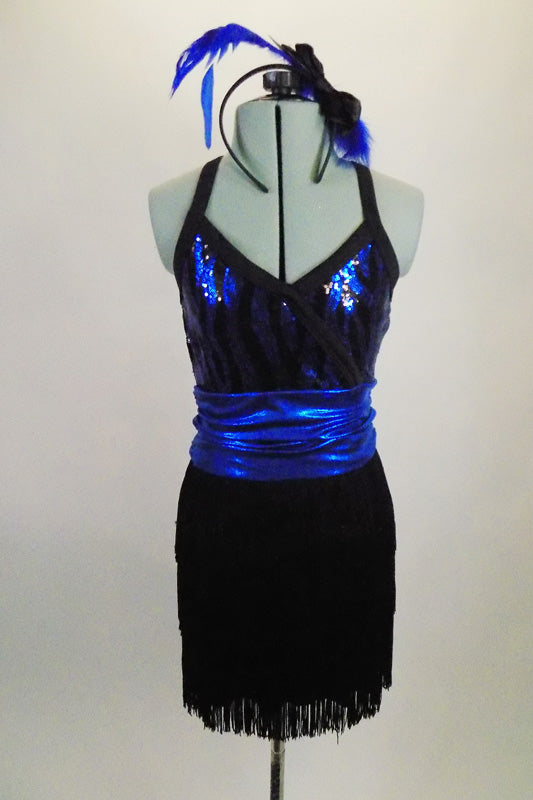 Black & blue patterned cross-front sequined top is attached to a black layered fringe skirt. The skirt and top are accented by a blue metallic cummerbund belt. Comes with matching hair accessory. Front