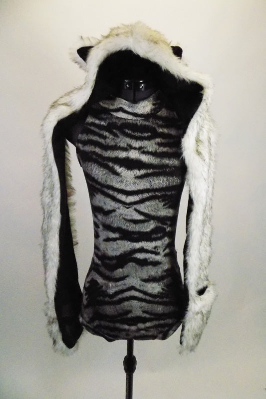 Black and grey animal print leotard has black sheer back. The costume is completed by a furry wolf-hood shawl complete with ears and hand insert paws. Front