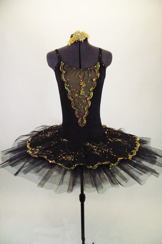 Black platter pull-on tutu with black & gold scalloped lace overlay compliments the matching leotard with gold lace front insert. Comes with gold hair barrette. Front