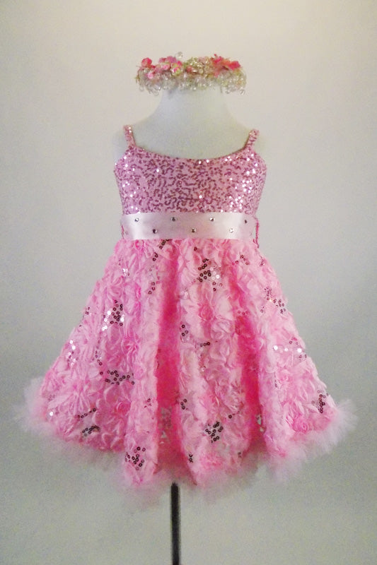 Pink rose floral sequined lace print A-line dress has wide satin, crystal covered satin band that snaps at back with bow. Comes with beaded -floral head wreath. Front