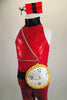 Red glitter lycra unitard has high neck, open sides & zip back. Large fabric clock sits at the left hip with gold chains. Comes with dynamite hair accessory. Front zoom