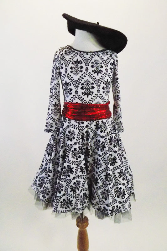 French flare, black and white damask motif, scoop neck dress has tulle crinoline and bright red tie belt. Comes with black felt beret hat. Front