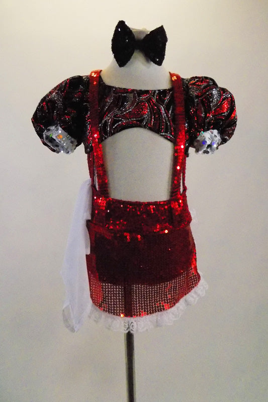 Silver red & black swirl, pouf sleeved half top is attached to red sequined shorts with side straps, red suspenders & sequined apron. Comes with dust cloth. Front
