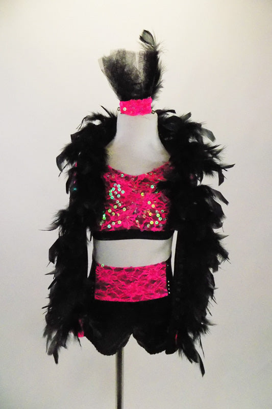 Pink & black three-piece costume has pink lace bra-top & black shorts with pink lace front. The  shrug has pink lace on sleeves and is adorned with feathers. Comes with feather hair accessory. Front