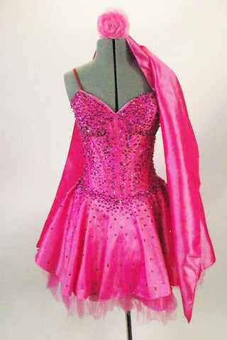 Sweetheart, boned mini dress is a shimmery rose-pink taffeta, covered with beading & crystals. Has attached pink crinoline, matching shawl & hair accessory. Front