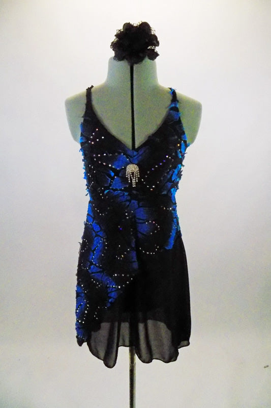 Black & blue angle dress has crackle pattern with crystal accents throughout over black chiffon. Costume has large Swarovski crystal brooch accent at bust and floral hair accessory. Front