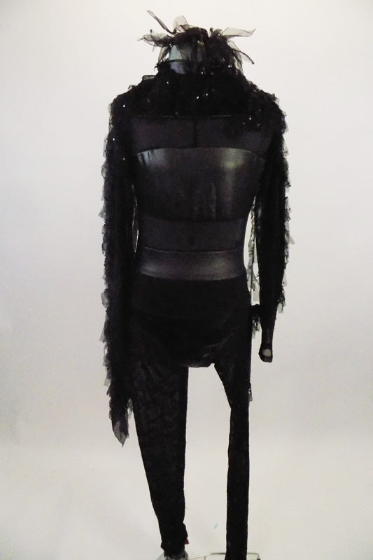 Leatherette and black sheer mesh paneled leotard has keyhole back & sequined lace leggings. There is also a sequined chiffon feather-like shrug for shoulder. Comes with matching hair accessory. Front