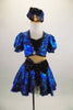 Black & blue 2-piece costume has black bust, nude mesh torso & attached blue skirt with bow at front. Comes with pouf sleeved bolero jacket & crystal button. Front