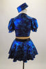 Black & blue 2-piece costume has black bust, nude mesh torso & attached blue skirt with bow at front. Comes with pouf sleeved bolero jacket & crystal button. Back