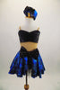 Black & blue 2-piece costume has black bust, nude mesh torso & attached blue skirt with bow at front. Comes with pouf sleeved bolero jacket & crystal button. Front without jacket