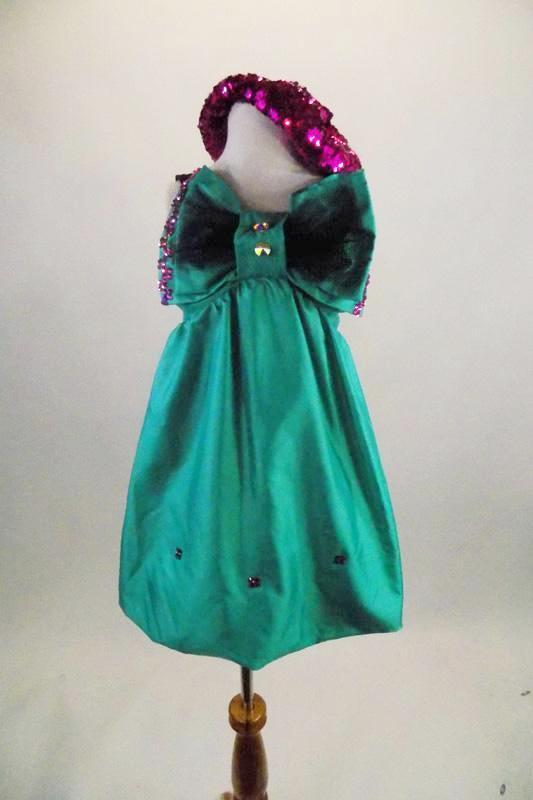 Green taffeta smocked back bubble dress has large crystaled bow accent that covers the bust & pink crystal accents. Comes with pink sequined beret & pink gloves. Front