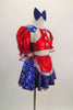 2-piece costume has a bright red half top with pouf sleeves, white fringed blue lasso print epaulets & buttons. Matching skirt has crinoline & red apron. Comes with blue hair bow. Side