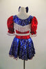 2-piece costume has a bright red half top with pouf sleeves, white fringed blue lasso print epaulets & buttons. Matching skirt has crinoline & red apron. Comes with blue hair bow. Bow