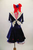Dark blue velvet dress has white crinoline & red star accents. The large white naval collar has front tie & striped inlay. Collar hash gold piping & red stars. Comes with large red hair bow. Front
