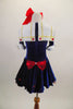Dark blue velvet dress has white crinoline & red star accents. The large white naval collar has front tie & striped inlay. Collar hash gold piping & red stars. Comes with large red hair bow. Back