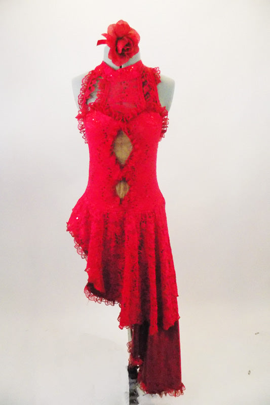 Red sequined lace dress has long angled satin & lace skirt that extend down the left side. Torso has nude mesh peek-a-boo holes & ruffled neck & straps. Comes with rose hair accessory. Front