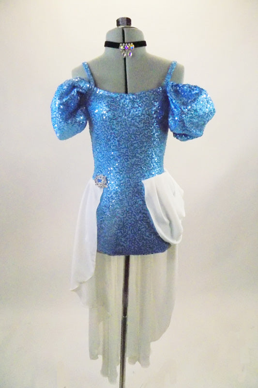 Cinderella themed costume is a blue sequined camisole leotard with long white attached open front chiffon skirt cascading from crystal jeweled brooch at hip. Front