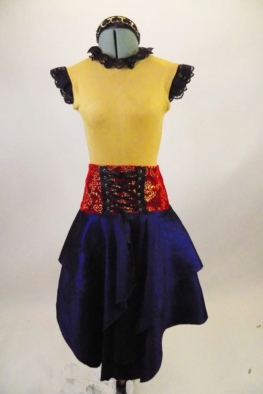Saloon wench, western themed costume has tan suede leotard with black lace trim. The taffeta skirt is a deep blue with red velvet damask corset belt. Comes with brown boots and headband. Front