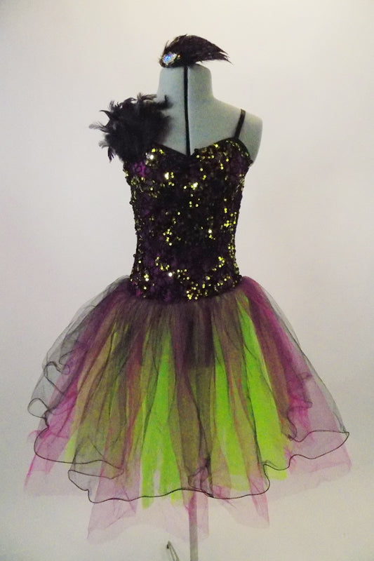 Magenta purple based dress has black lace overlay with lime green sequins & feather accent at right shoulder. The tulle skirt is layers of lime magenta & black. Comes with matching feather hair accessory. Front
