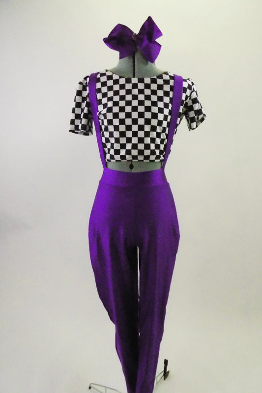 Black and white checkered short sleeve half-top is accompanied by purple leggings with suspenders. Comes with large bow accessory. Front