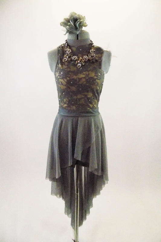 Grey crystalled lace dress has tank style bodice with deep open back & jeweled necklace. Sheer skirt is a cross-over high-low that comes to a point at back. Comes with matching hair accessory. Front