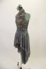 Grey crystalled lace dress has tank style bodice with deep open back & jeweled necklace. Sheer skirt is a cross-over high-low that comes to a point at back. Comes with matching hair accessory. Left side