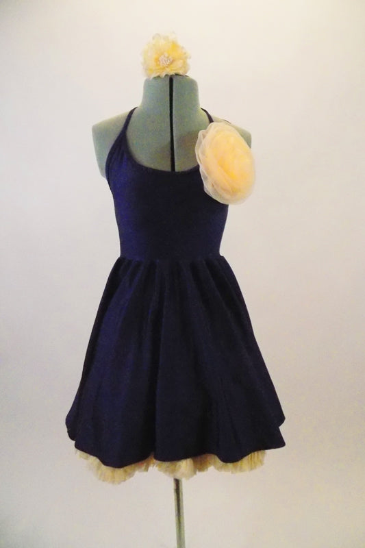 Navy blue halter stretch dress has a separate full multi-layered cream-colored petticoat. Has a large cream-colored flower accent at the left bust and hair. Front