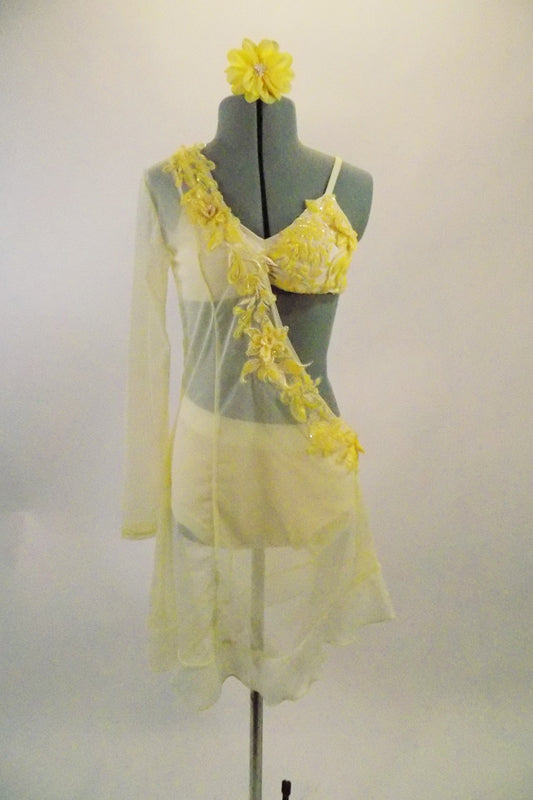 Buttercream yellow sheer single sleeved open sided tunic dress has beaded lace applique along collar & side. Appliqued bra & briefs sit below the sheer tunic. Comes with matching hair accessory. Front