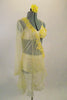 Buttercream yellow sheer single sleeved open sided tunic dress has beaded lace applique along collar & side. Appliqued bra & briefs sit below the sheer tunic. Comes with matching hair accessory. Right side