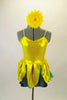 2-piece costume comes with dark green shorts &  yellow flower themed camisole dress with petals & a soft green underlay. Has yellow gerbera daisy hair clip. Front