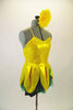 2-piece costume comes with dark green shorts &  yellow flower themed camisole dress with petals & a soft green underlay. Has yellow gerbera daisy hair clip. Side