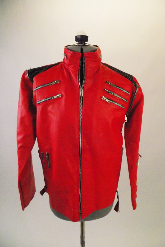Leatherette replica of Michael Jackson's jacket worn in the video. It is lined with zippers accenting the chest, sleeves, shoulders neck & sides. Shoulders have black sequined accent. Front