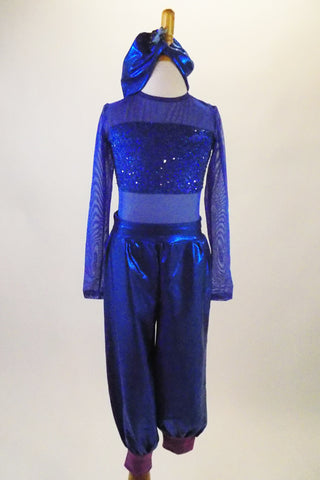 Blue 2-piece costume has mesh leotard with blue sequined bust band. The matching blue shiny harem pants have wide purple cuffs. Comes with turban style headband. Front