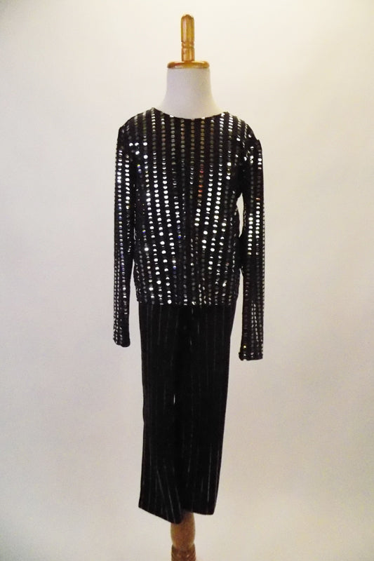 Black & silver sequined long sleeved straight cut top with a bit of sparkle is accompanied by elastic waist, silver pinstripe pants. Front